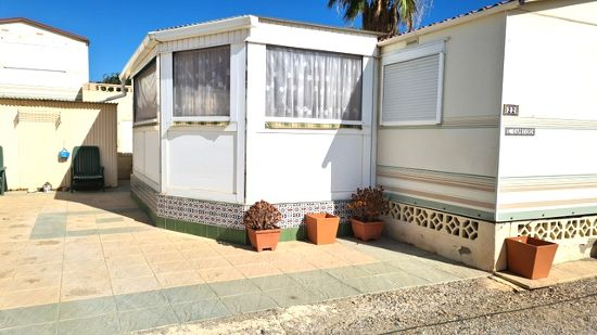 Outside of the luxury home : 3 bed, 1 bath mobile home for sale in Los Hibiscus
