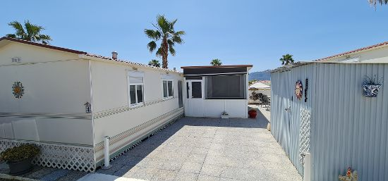 Outside of the home for sale : 2 bed, 1 bath mobile home for sale in Las Bouganvillas
